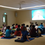 Children inside the meditation hall during a children's course